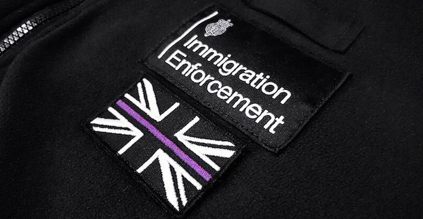 Badge of Immigration Enforcement Officer Investigating Illegal Workers